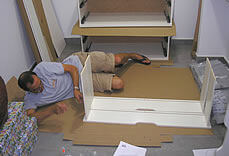 Bob, assembling furniture